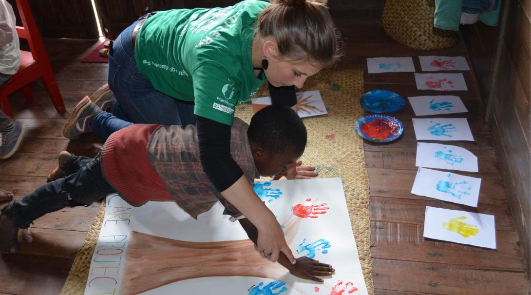 A Projects Abroad volunteer plays with a boy during her volunteer with children project in Madagascar.